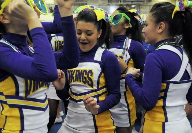 Westhill cheerleaders dance during an intermission at the FCIAC Cheerleading championships at Wilton High School on Saturday, February 4, 2012. Photo: Lindsay Niegelberg / Stamford Advocate