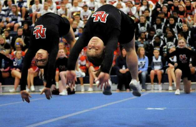 New Canaan High School cheerleaders perform during the FCIAC Cheerleading championships at Wilton High School on Saturday, February 4, 2012. Photo: Lindsay Niegelberg / Stamford Advocate