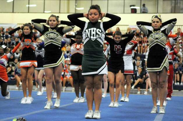 Cheerleaders perform in the all-FCIAC group during the FCIAC Cheerleading championships at Wilton High School on Saturday, February 4, 2012. Photo: Lindsay Niegelberg / Stamford Advocate