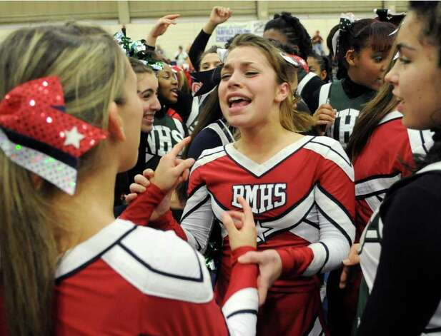 Cheerleaders dance during an intermission at the FCIAC Cheerleading championships at Wilton High School on Saturday, February 4, 2012. Photo: Lindsay Niegelberg / Stamford Advocate