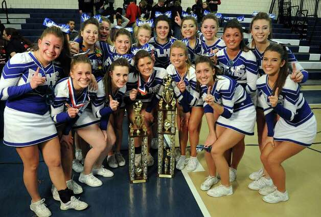 Fairfield Ludlowe cheerleaders celebrate winning first place in the all-girls division of the FCIAC Cheerleading championships at Wilton High School on Saturday, February 4, 2012. Photo: Lindsay Niegelberg / Stamford Advocate