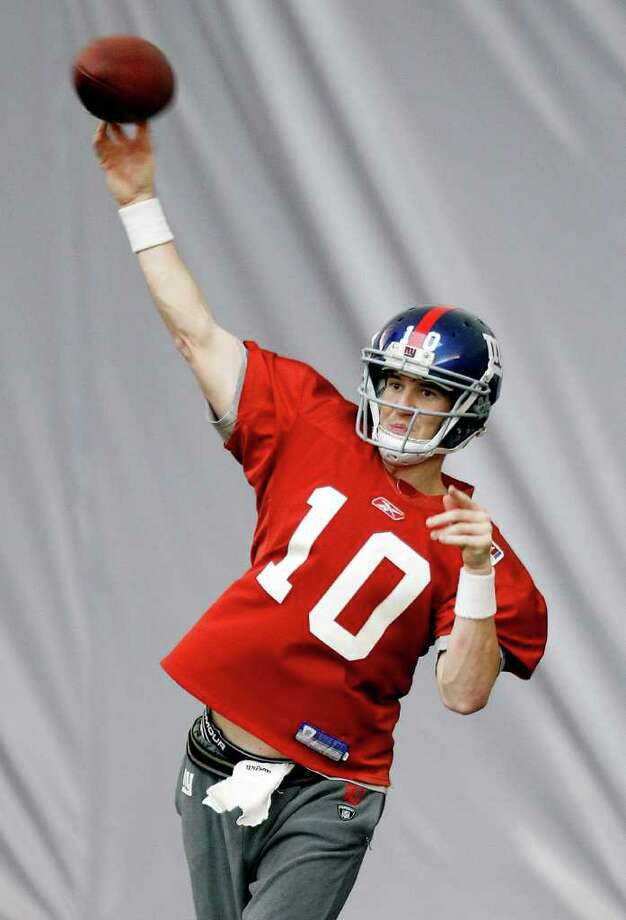 New York Giants' Eli Manning throws during practice, Thursday, Feb. 2, 2012, in Indianapolis. The Giants will face the New England Patriots in the NFL football Super Bowl XLVI  on Feb. 5. Photo: AP