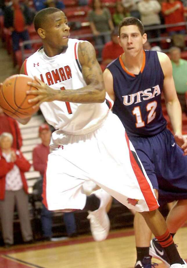 Lamar's Anthony Miles saves the ball from going out of bounds during the game against UTSA at the Montagne Center at Lamar University in Beaumont, Saturday, February 4st, 2012. Tammy McKinley/The Enterprise Photo: TAMMY MCKINLEY