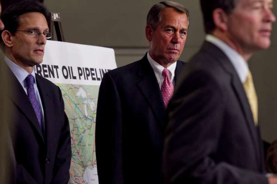 House Majority Leader Eric Cantor, left, and House Speaker John Boehner, center,  say the Keystone pipeline project is needed for energy and jobs. Photo: STEPHEN CROWLEY / NYTNS