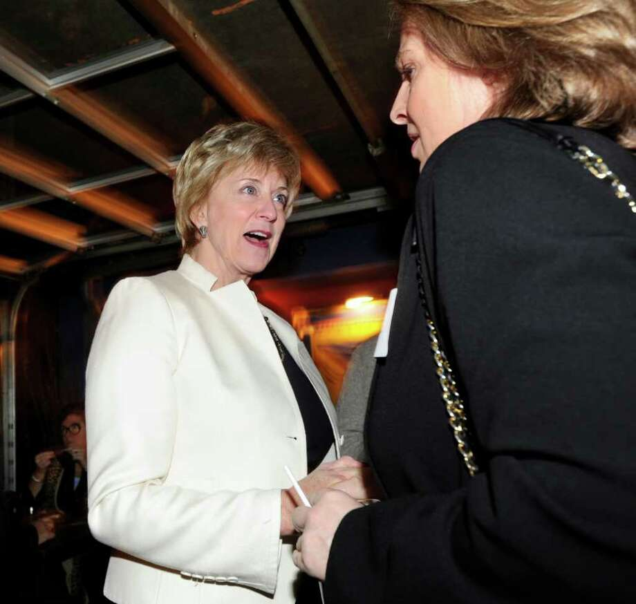 Republican U.S. Senate candidate Linda McMahon, left, meets Clare Powell of Stamford during an appearance at SBC Restaurant & Brewery in Stamford, Thursday night, Feb. 2, 2012. Photo: Bob Luckey / Greenwich Time