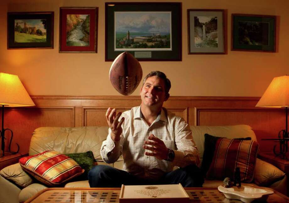 Craig James keeps his eye on the ball Friday at his father-in-law's home in The Woodlands. The former football star is now running for the U.S. Senate in Texas. Photo: Cody Duty / © 2011 Houston Chronicle