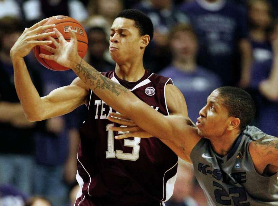 Kansas State guard Rodney McGruder (22) knocks the ball away from Texas A&M guard Jordan Green (13) during the second half of an NCAA college basketball game on Saturday, Feb. 4, 2012, in Manhattan, Kan. Kansas State defeated Texas A&M 64-53. Photo: AP