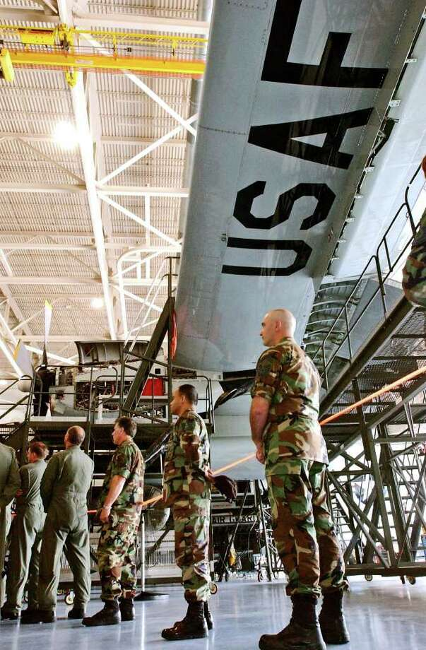 Guardsmen Mark Giaquinto (at right) and Pedro Negron Jr. stand beneath United States Air Force  C-130 at the Stratton Air National Guard Base in Glenville N.Y. Monday August 29, 2005. (Times Union archive) Photo: Shannon DeCelle