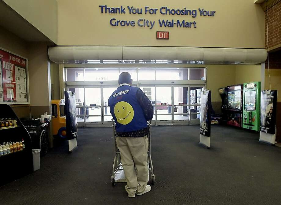 Wal- Mart associate and greeter Clarence Hatfield ARE waits for customers at the front doors of the company's SuperCenter store in Grove City, Ohio Thursday, March 2, 2006. Shoppers curbed spending at U.S. retailers in February as a blast of winter weather hurt demand for spring apparel. Stores had their smallest sales gain in nine months. Photographer: Jay LaPrete/Bloomberg News Wal-Mart associate and greeter Clarence Hatfield ARE  waits for customers at the front doors of the company's SuperCenter store in Grove City, Ohio Thursday, March 2, 2006. Shoppers curbed spending at U.S. retailers in February as a blast of winter weather hurt demand for spring apparel. Stores had their smallest sales gain in nine months. Photographer: Jay LaPrete/Bloomberg News Photo: Jay LaPret, Bloomberg News