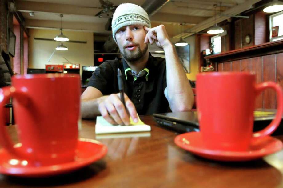 Coffee shop owner Anton Pasquill talks about city bureaucracy and the difficulties it creates for business owners on Wednesday, Feb. 1, 2012, at Hudson River Coffee House in Albany, N.Y. (Cindy Schultz / Times Union) Photo: Cindy Schultz /  00016289A
