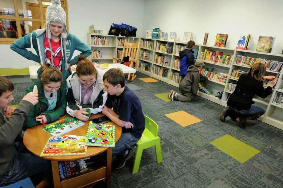 Michael weaver,Julia Beekman ,Sunny Dickerson, Kate Martin and Jacob Birsen,left, play a game in the children's section of the Middleburgh Library grand opening celebration in Middleburgh, New York Saturday Feb.4, 2012.( Michael P. Farrell/Times Union) Photo: Michael P. Farrell