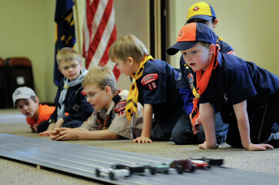 Scout Zack Wiseman, 7, watches the final heat during the Queen Anne Cub Scouts' annual Pinewood Derby at Bethany Presbyterian Church in Seattle on Saturday, Feb. 4, 2012. The derby is a chance for scouts, who were each given a block of wood to carve, to exercise their visual and aerodynamic design skills with help from family members. The Queen Anne Cub Scouts have been holding the derby since at least 1988. Photo: LINDSEY WASSON / SEATTLEPI.COM