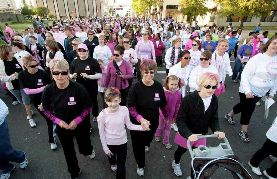 FILE - In this Saturday, Oct. 16, 2010 file photo, some of an estimated 45,000 people participate in the Susan B. Komen Race for the Cure in Little Rock, Ark. After watching The Susan G. Komen for the Cure announce plans to cut funding to Planned Parenthood on Tuesday, Jan. 31, 2012, then abandon those plans days later amid a public furor, many longtime Komen supporters were feeling conflicted at week's end. (AP Photo/Brian Chilson) Photo: Brian Chilson