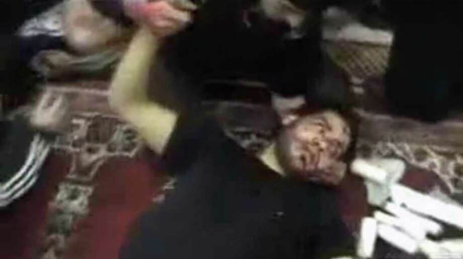 This image from amateur video made available by Shaam News Network on Saturday, Feb. 4, 2012, purports to show a wounded man being treated at a field hospital in Homs, Syria. Syrian forces unleashed a barrage of mortars and artillery on the battered city of Homs for hours before dawn on Saturday, sending terrified residents fleeing into basements and killing scores of people in what appeared to be the bloodiest episode in the nearly 11-month-old uprising, activists said.(AP Photo/Shaam News Network via APTN) THE ASSOCIATED PRESS CANNOT INDEPENDENTLY VERIFY THE CONTENT, DATE, LOCATION OR AUTHENTICITY OF THIS MATERIAL.  TV OUT Photo: Anonymous / Shaam News Network