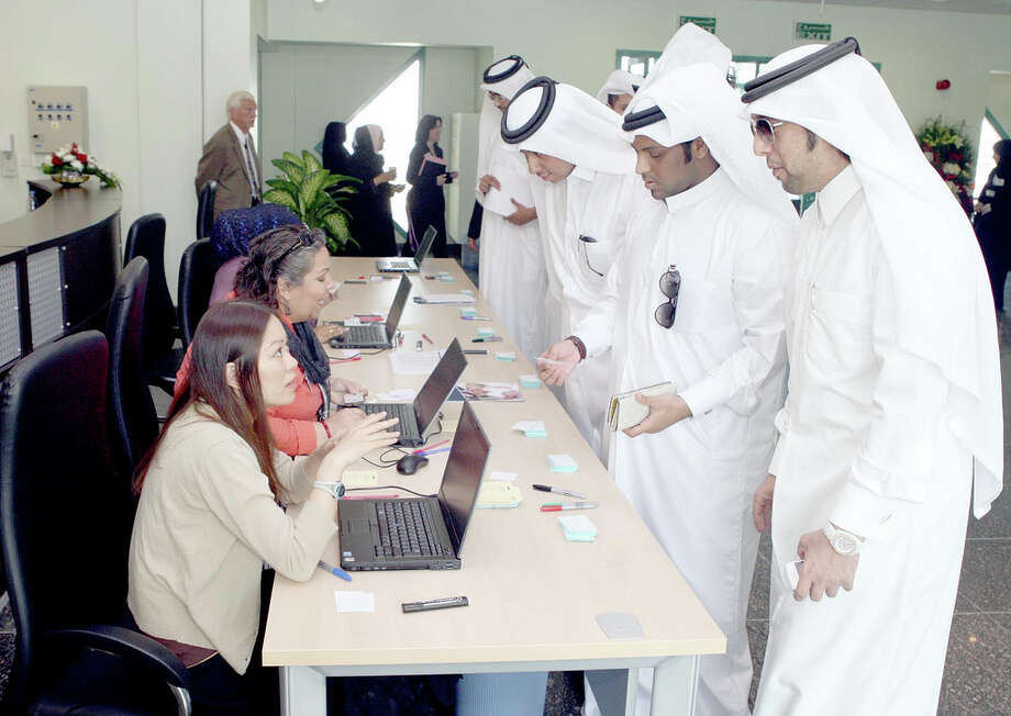 Male students register for classes at the HCC campus in Qatar. The government decided that, despite a signed contract, women would be taught separately.