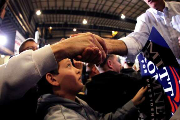 Republican presidential candidate, former Massachusetts Gov. Mitt Romney, greets supporters after speaking at a campaign rally in Colorado Springs, Colo., Saturday, Feb. 4, 2012. (AP Photo/Gerald Herbert)