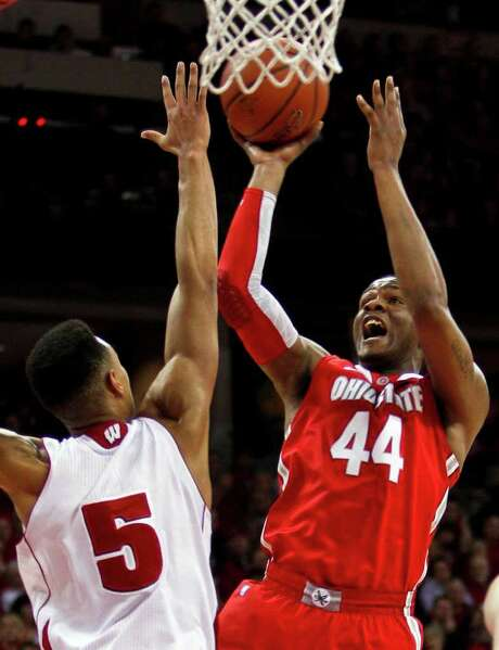 Ohio State's William Buford (44) shoots against Wisconsin's Ryan Evans during the first half of an NCAA college basketball game Saturday, Feb. 4, 2012, in Madison, Wis. Photo: AP