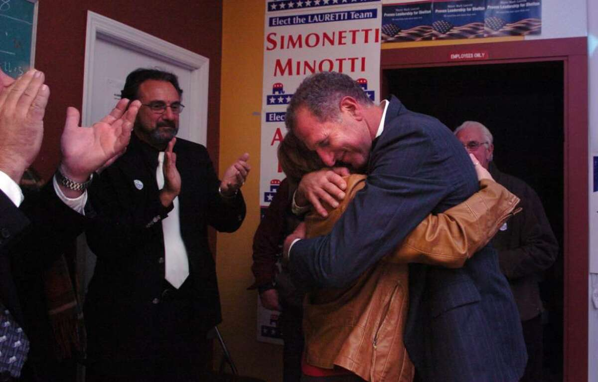 Shelton Mayor Mark A. Lauretti hugs his wife Anndee after being re-elected in Tuesday's race against challenger Chris Jones.