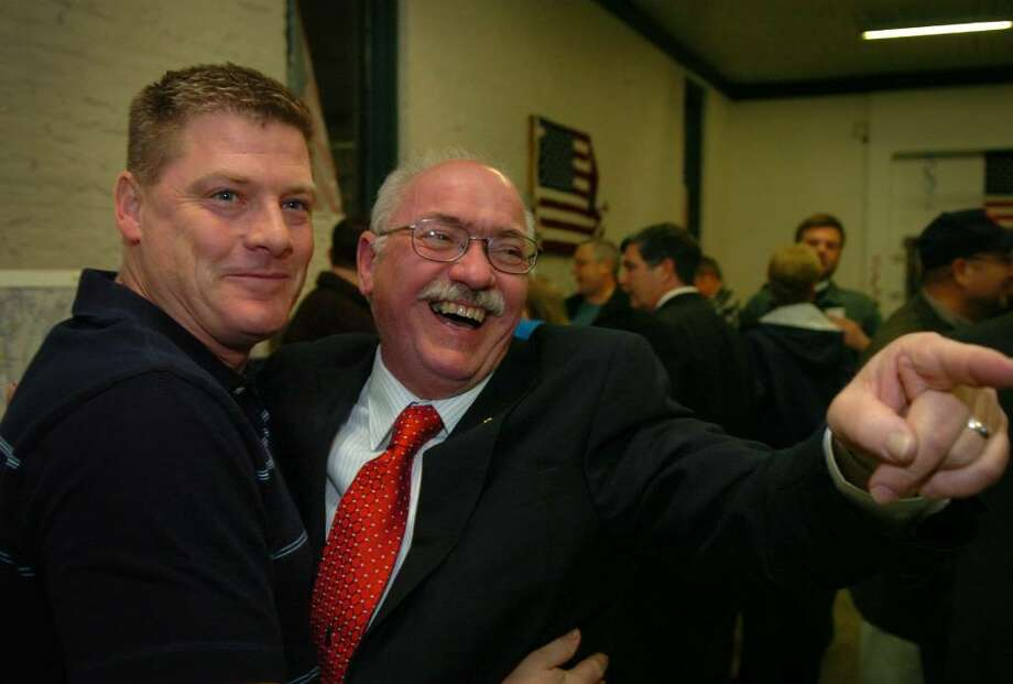 Paul Roy, right, hugs his co-worker Ed McGee of Brookfield after Roy was elected as Seymour first selectman on Tuesday night. Photo: Brian A. Pounds / Connecticut Post