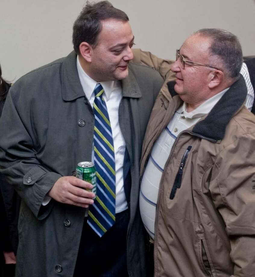 Counselman Benjamin Chianese, winner of the 6th ward and counselman Fred Visconti, winner of the 5th ward congratulate each other at the Democratic Headquarters. Tuesday, Nov. 3, 2009 Photo: Scott Mullin / The News-Times
