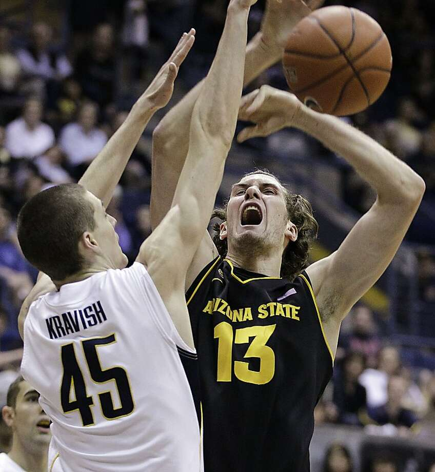 California's David Kravish (45) blocks the shot of Arizona State center Jordan Bachynski (13) during the first half of an NCAA college basketball game Saturday, Feb. 4, 2012, in Berkeley, Calif. (AP Photo/Ben Margot) Photo: Ben Margot, Associated Press