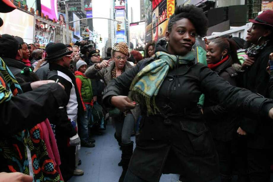 "Participants of a ""Soul Train"" line flash mob make their way along the line during a tribute to ""Soul Train"" creator Don Cornelius Saturday Feb. 4, 2012 in New York's Times Square. Photo: AP"