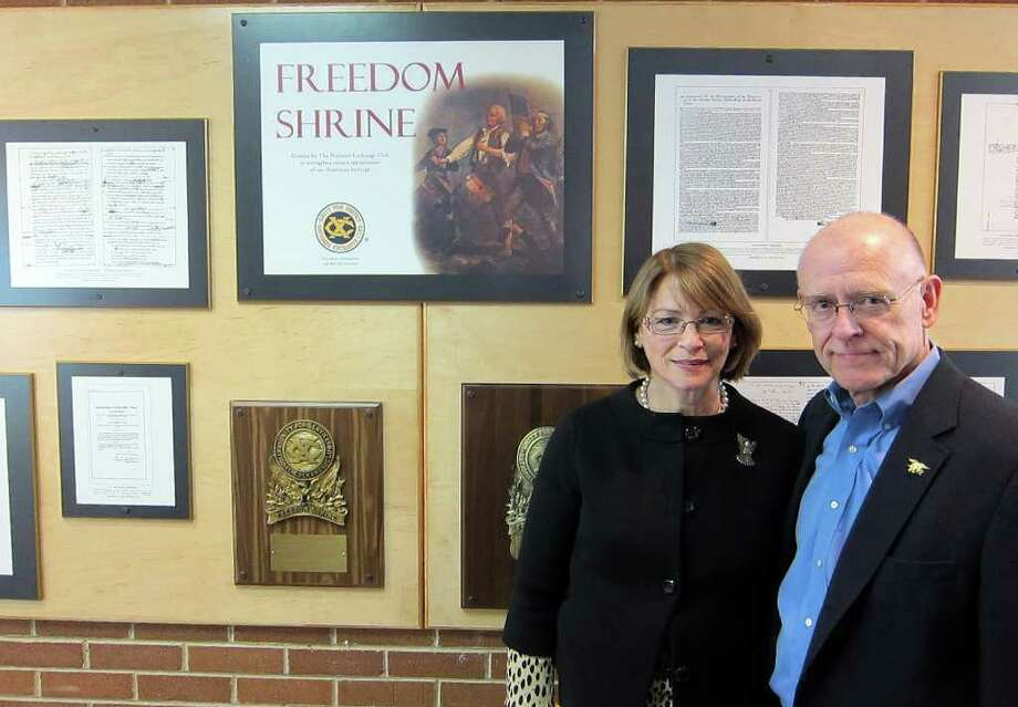 Patricia and Dr. Michael Parry stand in front of the Freedom Shrine dedicated to their son at Trinity Catholic High School on Newfield Avenue following a ceremony Saturday morning Feb. 4. Their son, Chief Petty Officer Brian Bill of the U.S. Navy SEALs, was among 30 U.S. soliders killed in a helicopter crash in Afgahnistan last summer. Photo: Jeff Morganteen / Stamford Advocate