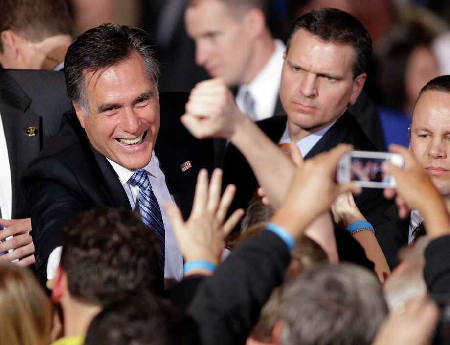 Republican presidential candidate former Massachusetts Gov. Mitt Romney greets supporters at his Nevada caucus night victory celebration in Las Vegas, Saturday, Feb. 4, 2012. Photo: AP