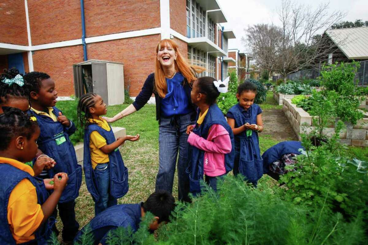 Gracie Cavnar, Recipe for Success director, talks with Jayla Perry, 6, left, and Indiya Fields, 7, during a nutrition lesson at MacGregor Elementary School in Houston. Her van service will provide fresh food for neighborhoods.