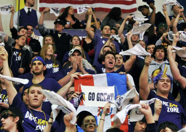 UAlbany fans cheer during Saturday's game at SEFCU Arena in Albany Feb. 4, 2012.   (John Carl D'Anni