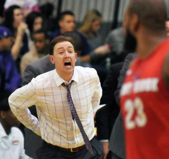 UAlbany coach Will Brown calls out to his players during Saturday's game at SEFCU Arena in Albany Fe