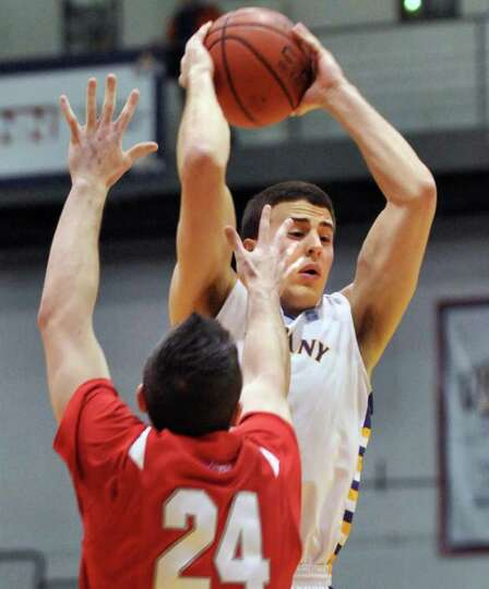 UAlbany's. #2 Logan Aronhalt,top, and Stony Brook's #24, Tommy Brenton during Saturday's game at SEF