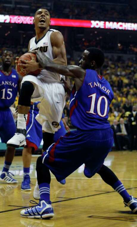 COLUMBIA, MO - FEBRUARY 04: Phil Pressey #1 of the Missouri Tigers drives to the basket past Tyshawn Taylor #10  of the Kansas Jayhawks during the first half at Mizzou Arena on February 4, 2012 in Columbia, Missouri. Photo: Ed Zurga, Getty Images / 2012 Getty Images