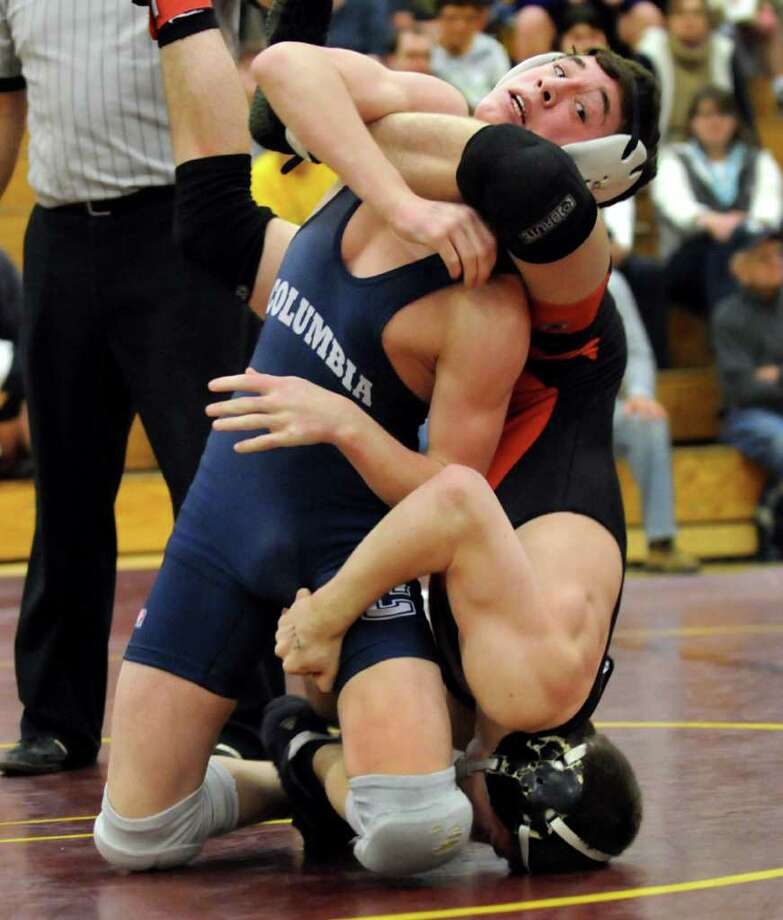 Columbia's John McHugh, left, grapples Bethlehem's Matt Morris at 113 pounds during the Class A Wrestling Sectional Semifinals on Saturday, Feb. 4, 2012, at Colonie High in Colonie, N.Y. Morris wins 10-8 in overtime. (Cindy Schultz / Times Union) Photo: Cindy Schultz / 00016189A
