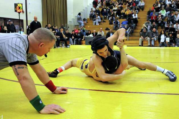 Saratoga's Dominic Inzana, top, grapples with Colonie's Golan Cohen at 106 pounds during the Class A Wrestling Sectional Semifinals on Saturday, Feb. 4, 2012, at Colonie High in Colonie, N.Y. (Cindy Schultz / Times Union) Photo: Cindy Schultz / 00016189A