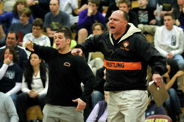 Bethlehem's coach Chris Bragh, right, cheers on Matt Morris as he grapples Columbia's John McHugh at 113 pounds during the Class A Wrestling Sectional Semifinals on Saturday, Feb. 4, 2012, at Colonie High in Colonie, N.Y. Morris wins 10-8 in overtime. (Cindy Schultz / Times Union) Photo: Cindy Schultz / 00016189A