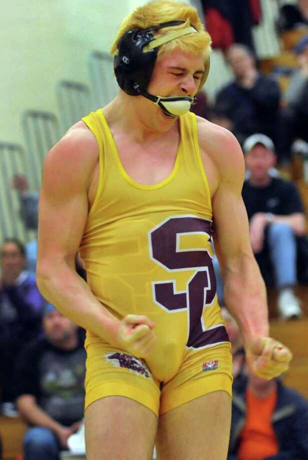 Colonie's Phil Bazacki strikes a power pose when he pins Guilderland's Nick Haluska at 145 pounds during the Class A Wrestling Sectional Semifinals on Saturday, Feb. 4, 2012, at Colonie High in Colonie, N.Y. (Cindy Schultz / Times Union) Photo: Cindy Schultz / 00016189A