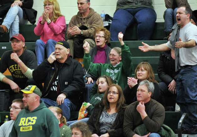 Wrestling fans cheer their teams during the Class C sectional wrestling tournament at Ravena High School Saturday Feb. 4, 2012.    (John Carl D'Annibale / Times Union) Photo: John Carl D'Annibale / 00016190A