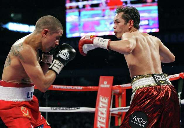 Wilfredo Vazquez, Jr. (left) and Nonito Donaire  exchange punches during the 12th round of their WBO junior featherweight title fight Saturday Feb. 4, 2012 at the Alamodome.  Donaire won the fight. Photo: EDWARD A. ORNELAS, Express-News / © SAN ANTONIO EXPRESS-NEWS (NFS)