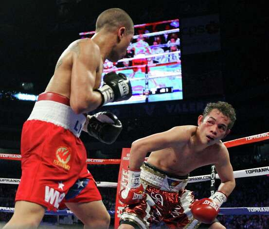 Nonito Donaire (right) pauses during the eighth round of his WBO junior featherweight title fight with Wilfredo Vazquez, Jr.  Saturday Feb. 4, 2012 at the Alamodome. Donaire  won the fight. Photo: EDWARD A. ORNELAS, Express-News / © SAN ANTONIO EXPRESS-NEWS (NFS)