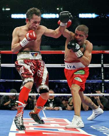 Nonito Donaire (left) and Wilfredo Vazquez, Jr. exchange punches during the eight round of  their WBO junior featherweight title fight Saturday Feb. 4, 2012 at the Alamodome. Donaire won the fight. Photo: EDWARD A. ORNELAS, Express-News / © SAN ANTONIO EXPRESS-NEWS (NFS)