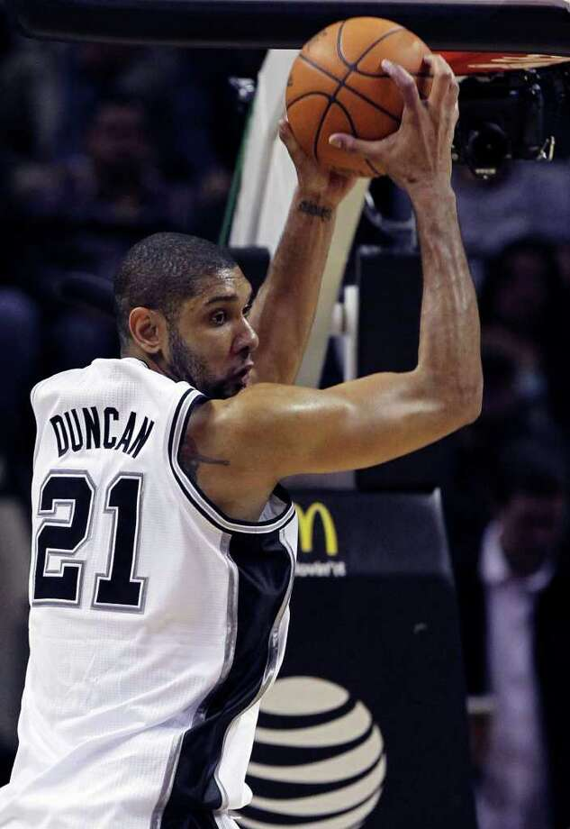 Spurs center Tim Duncan rips down a defensive rebound in the second half as the San Antonio Spurs play the Oklahoma City Thunder at the AT&T Center  on February 4, 2012 Tom Reel/ San Antonio Express-News Photo: TOM REEL, Express-News / San Antonio Express-News