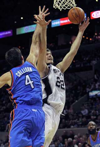 Spurs forward Tiago Splitter puts up a layup against Nick Cllision as  the San Antonio Spurs play the Oklahoma City Thunder at the AT&T Center  on February 4, 2012 Tom Reel/ San Antonio Express-News Photo: TOM REEL, Express-News / San Antonio Express-News