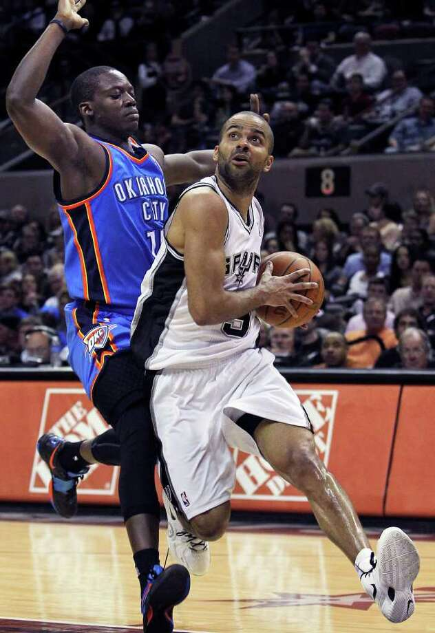 Spurs guard Tony Parker continues the move against Reggie Jackson which gets him to the bucket in the second half as the San Antonio Spurs play the Oklahoma City Thunder at the AT&T Center  on February 4, 2012 Tom Reel/ San Antonio Express-News Photo: TOM REEL, Express-News / San Antonio Express-News