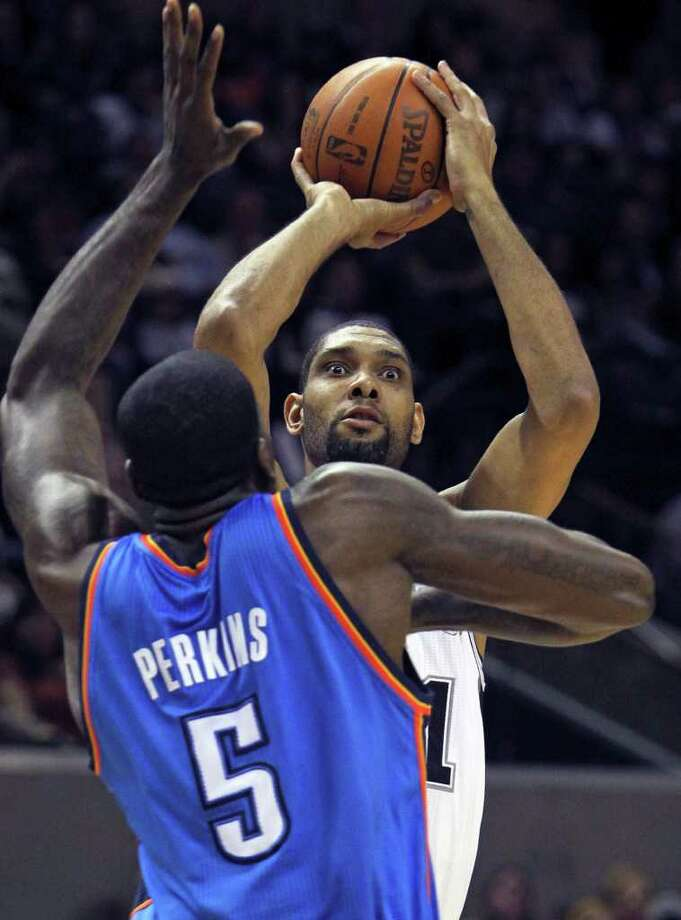 Spurs center Tim Duncan puts up a shot against Kendrick Perkins as the San Antonio Spurs play the Oklahoma City Thunder at the AT&T Center  on February 4, 2012 Tom Reel/ San Antonio Express-News Photo: TOM REEL, Express-News / San Antonio Express-News