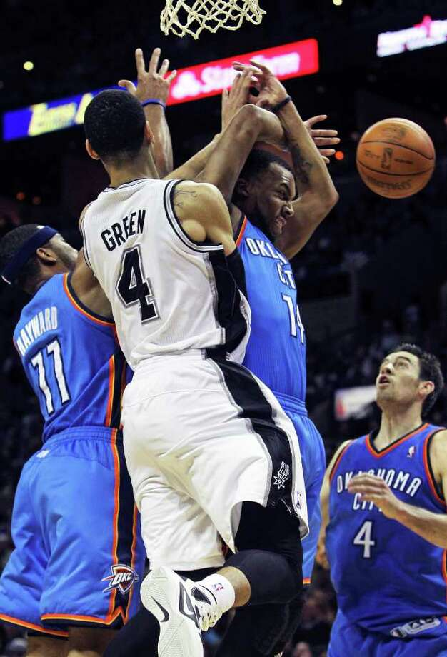 Spurs guard Danny Green causes havoc under the hoop as he pushes the ball through on a pass as the San Antonio Spurs play the Oklahoma City Thunder at the AT&T Center  on February 4, 2012 Tom Reel/ San Antonio Express-News Photo: TOM REEL, Express-News / San Antonio Express-News