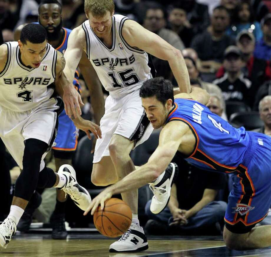 Thunder forward Nick Collision dives for a loose ball in front of Danny Green and Matt Bonner as the San Antonio Spurs play the Oklahoma City Thunder at the AT&T Center  on February 4, 2012 Tom Reel/ San Antonio Express-News Photo: TOM REEL, Express-News / San Antonio Express-News