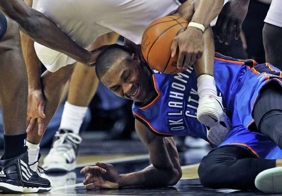 Thunder guard  Russell Westbrook gets kicked and stepped on trying to control a loose ball in the first half as  the San Antonio Spurs play the Oklahoma City Thunder at the AT&T Center  on February 4, 2012 Tom Reel/ San Antonio Express-News Photo: TOM REEL, Express-News / San Antonio Express-News
