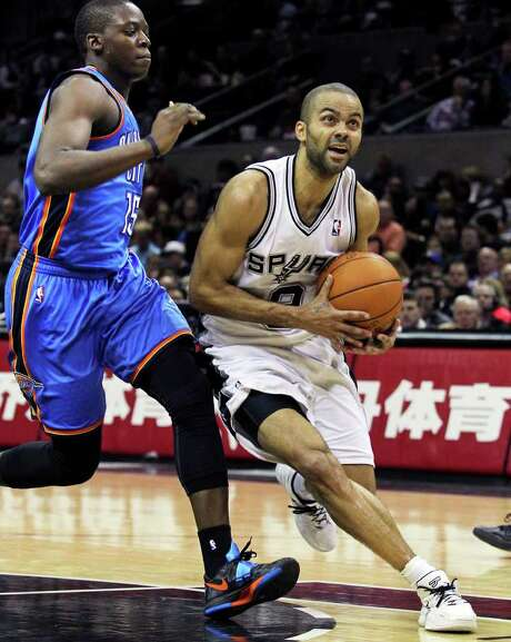 Tony Parker slips by Reggie Jackson during his 42-point, nine-assist effort Saturday, the Spurs' last home game until Feb. 29. Photo: TOM REEL, Express-News / San Antonio Express-News