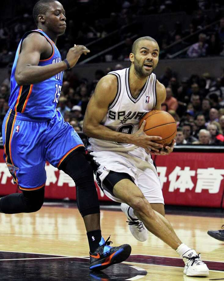 Spurs guard Tony Parker slips inside of Reggie  Jackson for a clear look at the bucket as the San Antonio Spurs play the Oklahoma City Thunder at the AT&T Center  on February 4, 2012 Tom Reel/ San Antonio Express-News Photo: TOM REEL, Express-News / San Antonio Express-News
